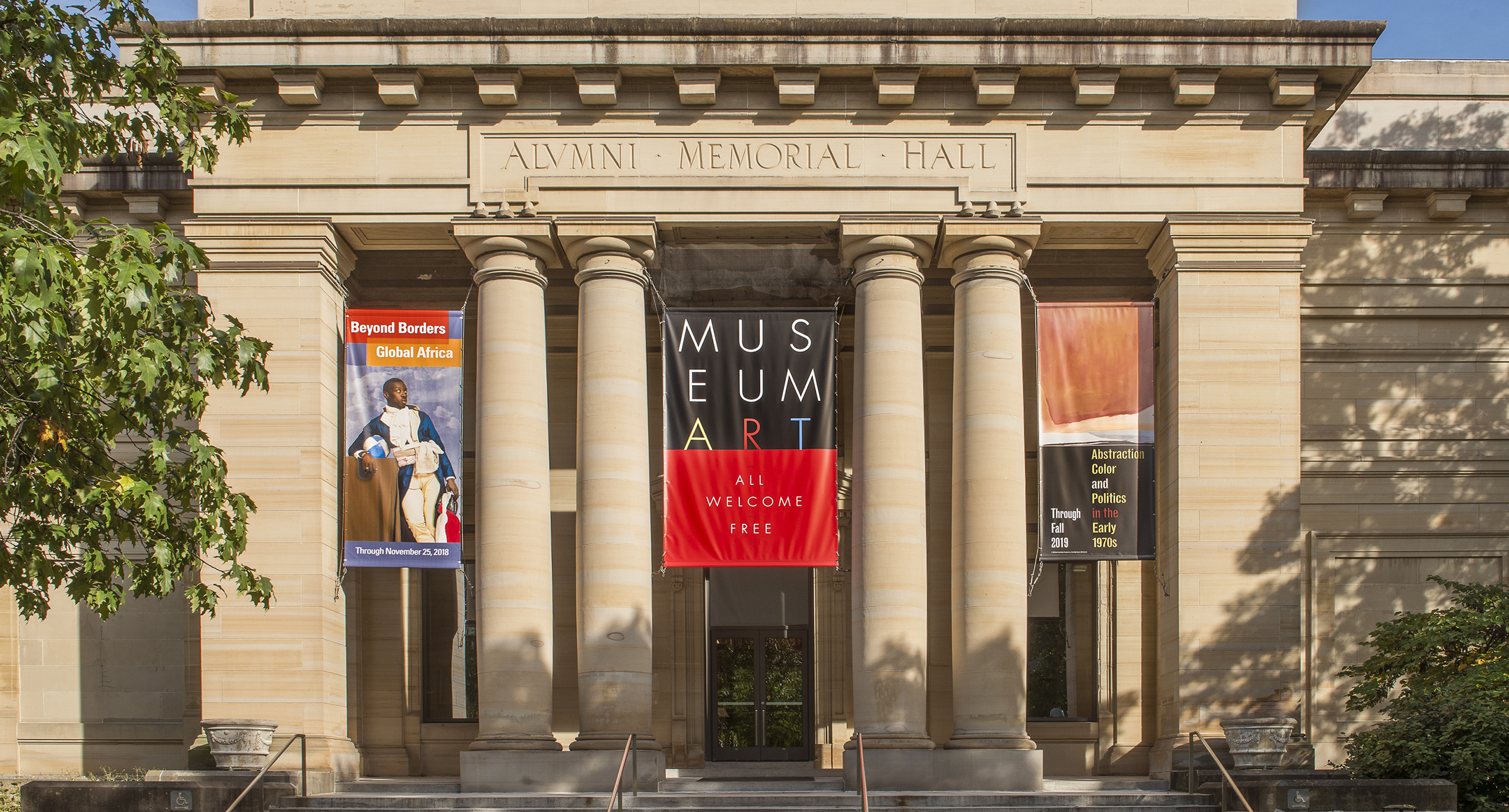 Image of UMMA entrance with banner above that reads: All, Welcome, Free